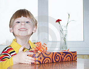 The Boy With A Gift Royalty Free Stock Photos - Image: 13901808