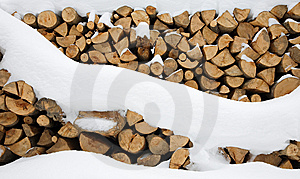 Firewood Stashed In Winter Stock Photos - Image: 13904453