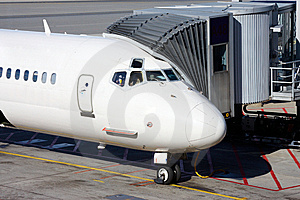 Airplane Near A Terminal Royalty Free Stock Image - Image: 13904906