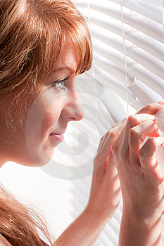Woman Looks Through Jalousie. Stock Photo - Image: 13906620