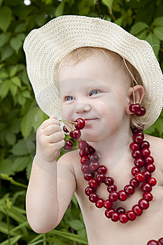 Girl With Red Cherry Beads And Earrings Royalty Free Stock Image - Image: 13909056