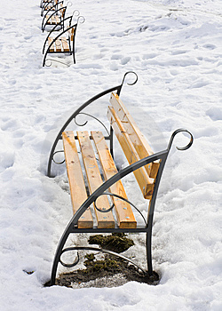 Light Brown Wooden Benches On Snow Stock Image - Image: 13911521
