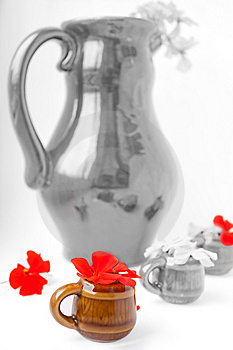 The Big Jug With Geranium And Mugs Royalty Free Stock Photography - Image: 13915707