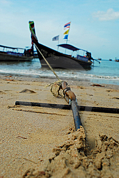Longboat Anchored On The Beach Stock Image - Image: 13915721