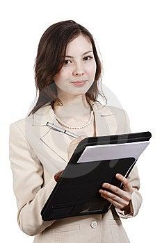 Girl Writing In Folder Stock Image - Image: 13917621