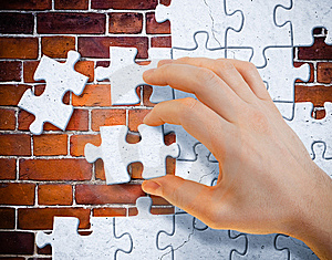 Hand With Stucco Puzzle Pieces Stock Photos - Image: 13927933