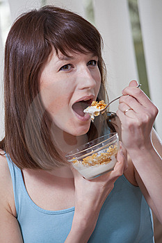 Woman Eating Corn Flakes Royalty Free Stock Photo - Image: 13928255