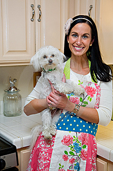 Smiling Woman With Cute Dog In Kitchen Stock Photography - Image: 13929532