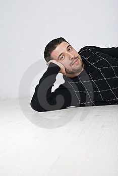 Attractive Man Sitting On Wooden Floor Stock Photography - Image: 13939042