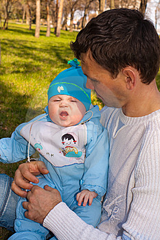 The Man Holds On Hands Of The Son, The Baby Cries Royalty Free Stock Photos - Image: 13942368