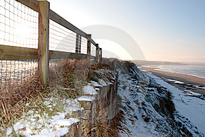 Cliff Edge Fence Over Beach Royalty Free Stock Photo - Image: 13942815