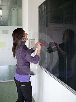 College Student Erasing The Chalkboard Stock Photography - Image: 13945432
