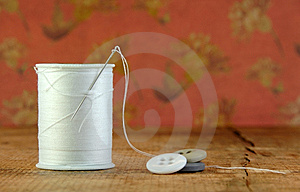Spool Of Blue Thread With A Needle And Buttons Stock Photos - Image: 13948213