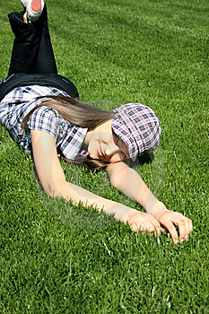 Pretty Girl Relaxing On The Grass Stock Image - Image: 13949341