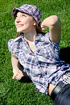 Young Caucasian Girl Sitting On The Green Grass Royalty Free Stock Photo - Image: 13949815