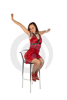 Sleepy Girl In Red Dress Sitting On The Chair Royalty Free Stock Photo - Image: 13949885