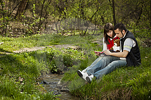 Young Couple In A Forest Stock Images - Image: 13952354