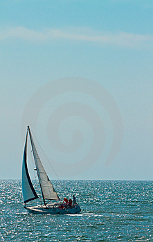 Solo Sailboat On Ocean Royalty Free Stock Image - Image: 13952756
