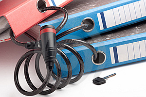 Three Folders  Linked  Together With Bicycle Lock Royalty Free Stock Photos - Image: 13959898