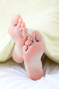 Feet Under Blanket Stock Photos - Image: 13964283