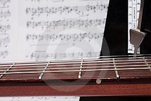 Closeup Guitar Neck, Notes And Metronome Royalty Free Stock Photos - Image: 13969118