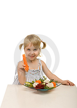 Little Girl Eating Vegetables - Chomping A Carrot Royalty Free Stock Image - Image: 13972076