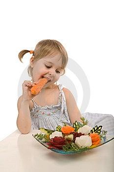 Little Girl Eating Vegetables - Chomping A Carrot Stock Images - Image: 13972094