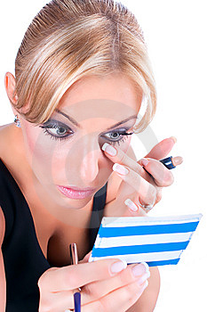The Woman  Paints Face With Makeup Royalty Free Stock Photos - Image: 13990278