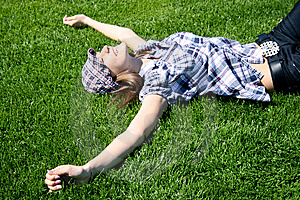 Young Girl Laying On The Grass Stock Image - Image: 13991151