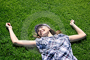 Young Girl Laying On The Grass Royalty Free Stock Image - Image: 13991166