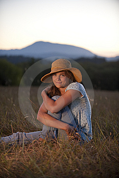 Teenage Girl Sitting In A Field Stock Photo - Image: 13991460