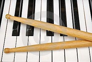 Drum Sticks On Piano Keyboard Royalty Free Stock Photo - Image: 13992405
