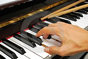 Right Hand Playing On Piano Keyboard Stock Image - Image: 13992731