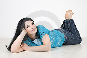 Pretty Woman Relaxing On Floor Stock Photos - Image: 13993313