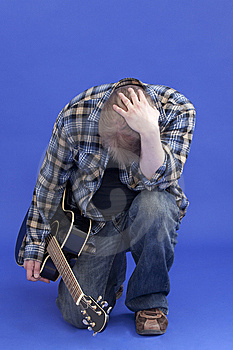 Portrait Of A Tired Guitarist Royalty Free Stock Images - Image: 13994299