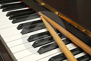 Diagonal Shot Of Drum Sticks On Piano Keyboard Stock Photo - Image: 13994590