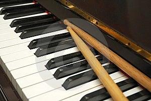 Diagonal Shot Of Drum Sticks On Piano Keyboard Stock Photo - Image: 13994590