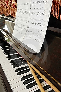 Music Score And Drum Sticks On Piano Keyboard Stock Photography - Image: 13994602