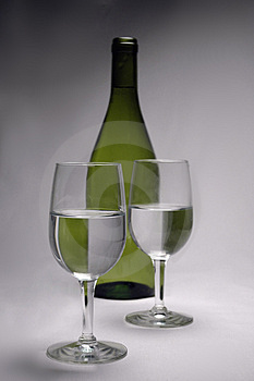 Glasses And A Bottle Stock Photography