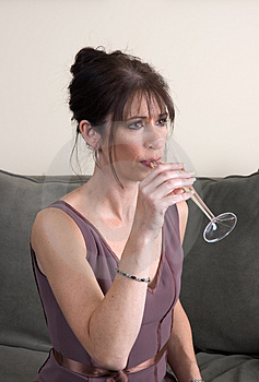 Woman Drinking Champagne On Couch Alone Royalty Free Stock Image - Image: 1407856