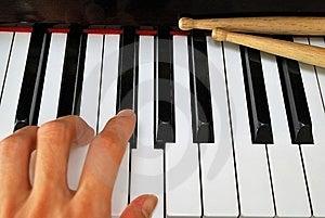 Left Hand Playing On Piano Keyboard Stock Image - Image: 14003421