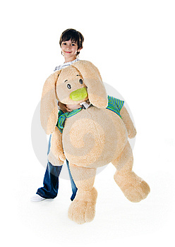 Cute Little Boy With A Big Rabbit Royalty Free Stock Photo - Image: 14008775