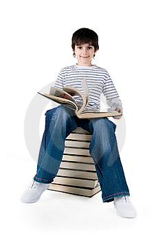 Cute Little Boy Sit On A Stack Of Big Books Royalty Free Stock Photography - Image: 14008857