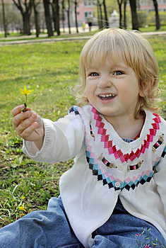 A Little Girl Gives A Flower Stock Image - Image: 14014761