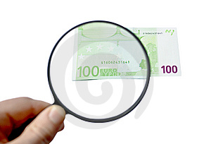 100 Euro Banknote Under The Magnifying Glass Stock Image - Image: 14016251