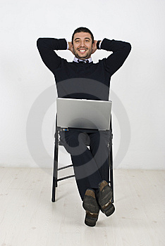 Happy Businessman With Laptop On Chair Stock Photo - Image: 14018340
