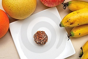 Contrast Of Fruits And Unhealthy Sweets Royalty Free Stock Photos - Image: 14019048