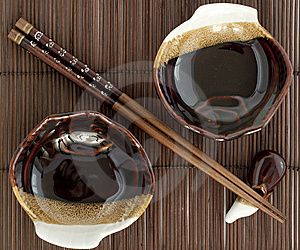 Sticks Fo Sushi And Two Plates On The Mat Royalty Free Stock Images - Image: 14025079