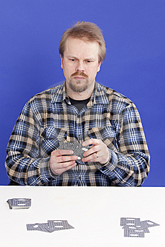 Man Mixes Cards Stock Photos - Image: 14027143