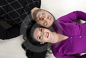 Top View Of  Happy Young Couple On Floor Royalty Free Stock Photo - Image: 14039655